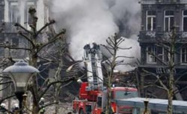 Belgian building collapses, 2 trapped under rubble