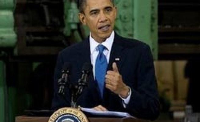 Obama warns job data to fluctuate in coming months