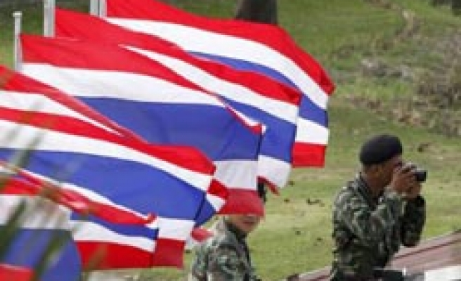 Thaksin backers rally at military bases against coup