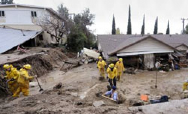 Mudslides damage dozens of homes in L.A. foothills