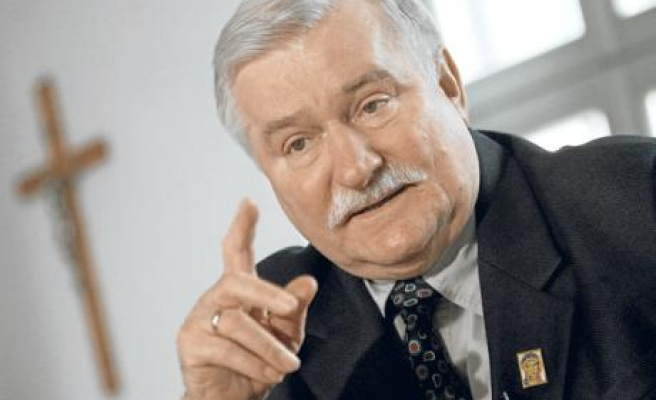 Ex Polish leader Walesa backs Komorowski for president