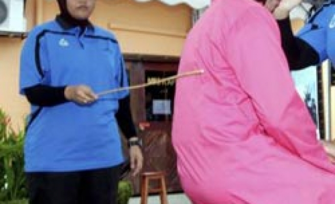 Malaysian women say deserved caning over adultery