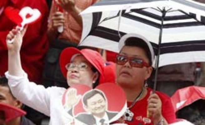 Pro-Thaksin protesters announce mass rally 'to topple govt'