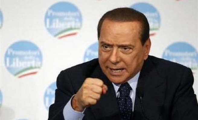 Italy's Berlusconi accuses judges of trying to topple him