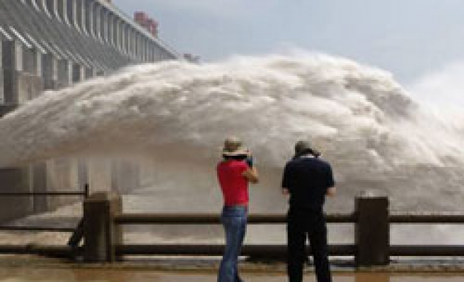 China floods wash explosive chemicals into river