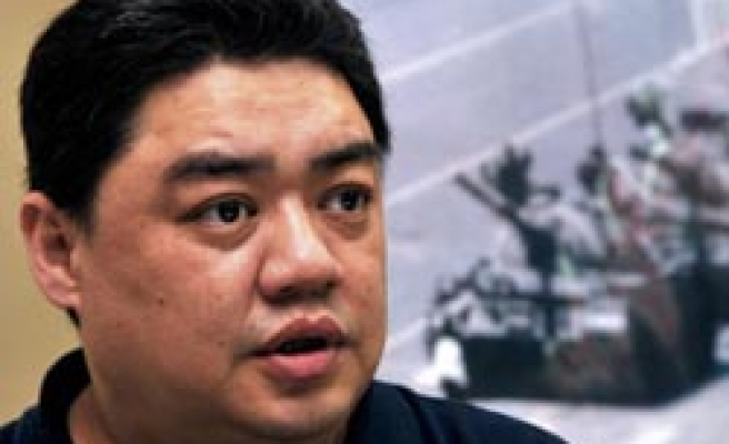 Uighur Tiananmen dissident wants family visit in China