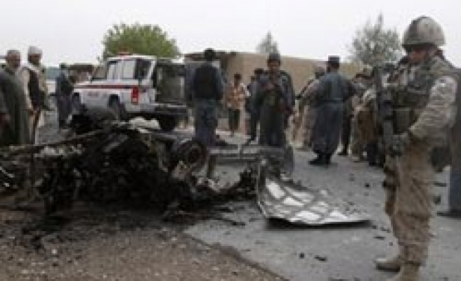 Bomb kills 4 Afghans in attack on district chief