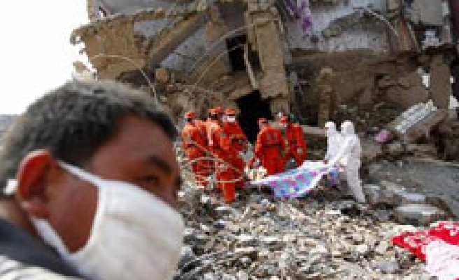 China landslide toll rises to 702 - official