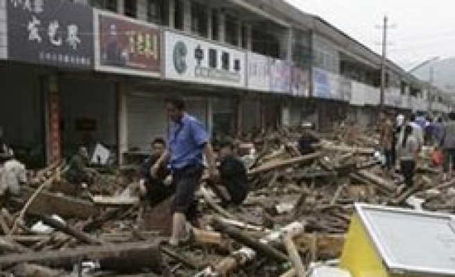Storms in west China kills 51 more people