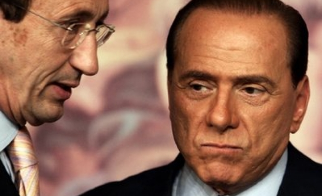 Berlusconi challenges rivals with Italy election threat