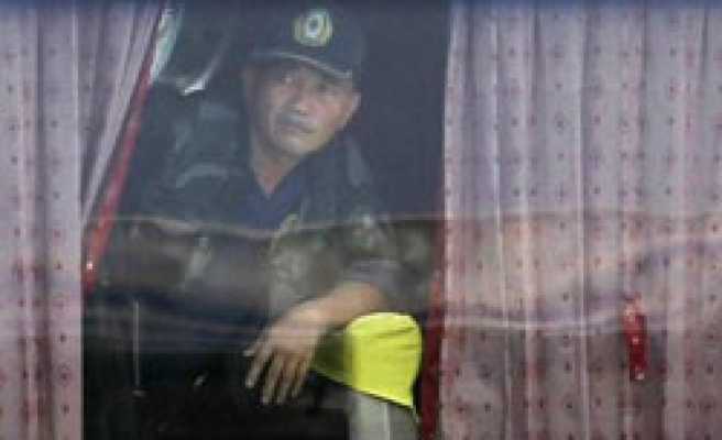 Philippine ex-policeman says he shot two hostages