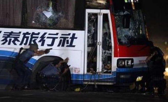 Philippine police says may have shot some bus hostages