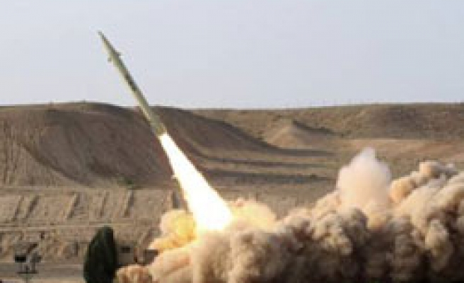 Iran test-fires new missile, says is friend to neighbours