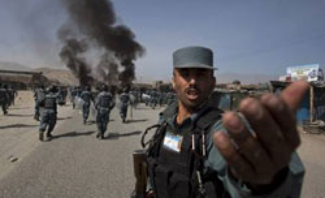 One Afghan dead, police fire thousands in anti-US protests