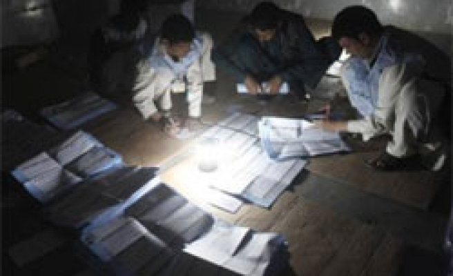 Fraud, low turnout mark Afghanistan poll