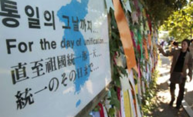 Koreas meet on reunions, South plans another drill with US
