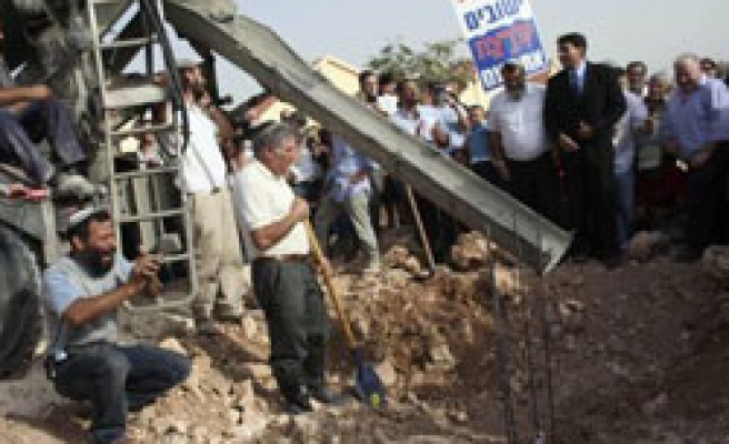 Israel defies building freeze calls as illegal settlers celebrate