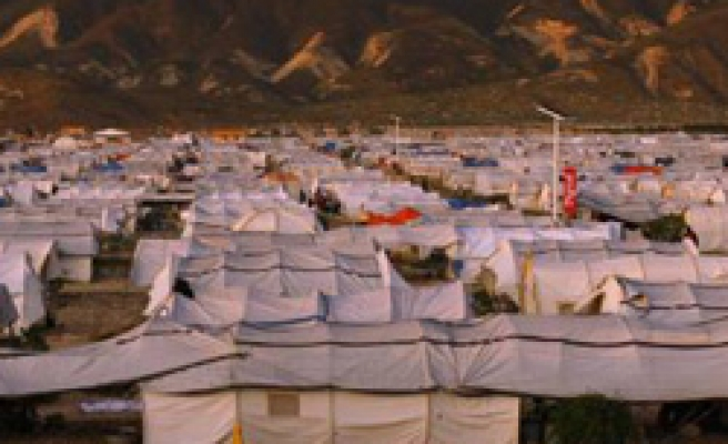 Haiti earthquake refugees moving out of resort camp