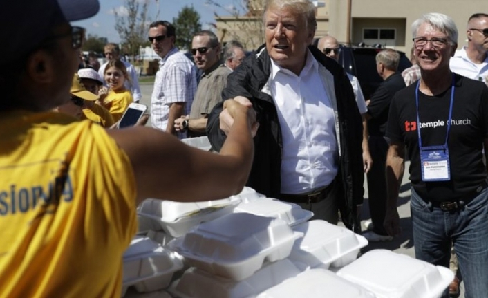 Trump visit Carolina as death toll rises from Florence
