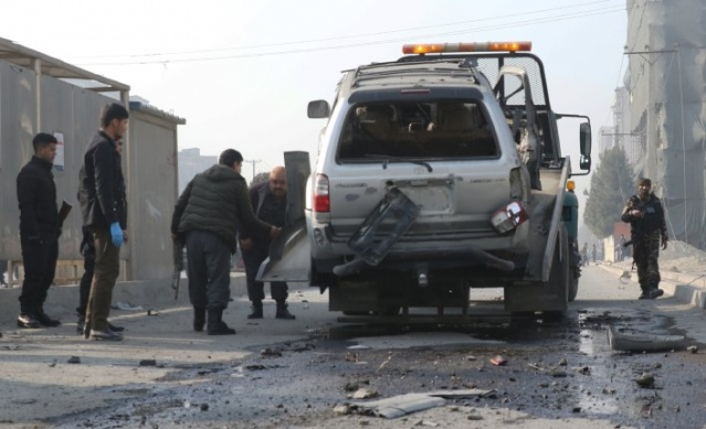 Afghan security officials carry vehicle damaged after the blast in Kabul, Afghanistan on February 02, 2021. Three blasts happened in different parts of Kabul in less than three hours on Tuesday morning, at least two people dead including Mohammad Atif, head of a council at Jamiat Eslah, a Kabul-based organization, and five more wounded officials confirmed.
