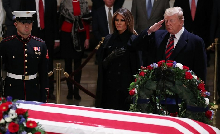 Trump pays respects as president Bush lies in state in US Capitol