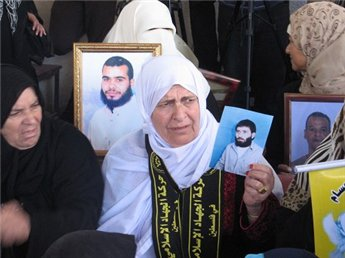 Palestinian families hold a demonstration in Ramallah