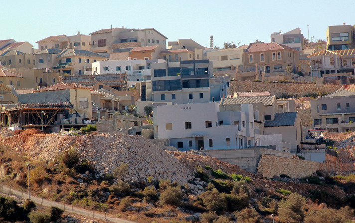 Israel vows to build more Jewish settlements on eve of peace talks