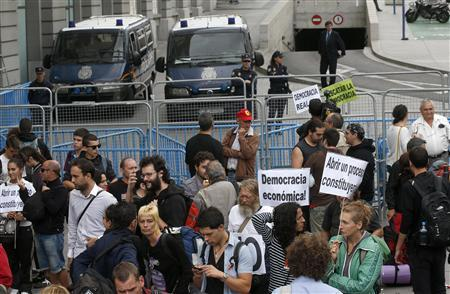 Spain prepares more austerity, protesters battle police