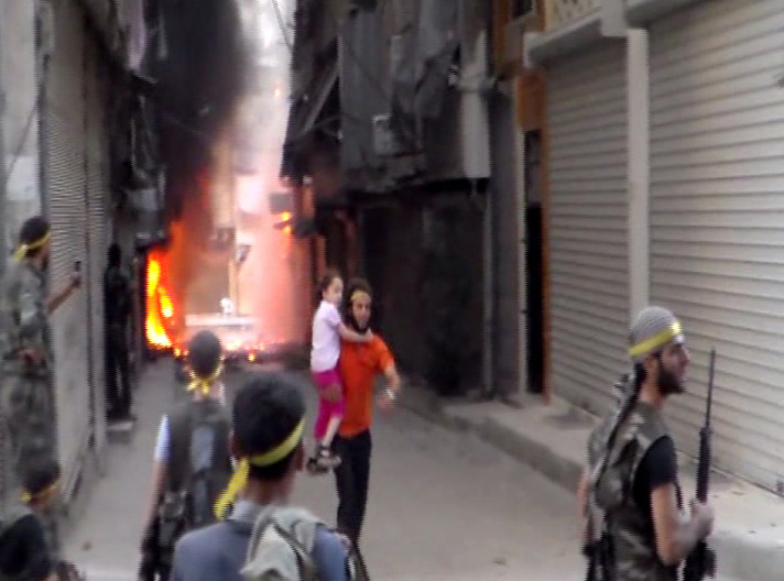 Ancient souk burns as fighting rages in Syria's Aleppo