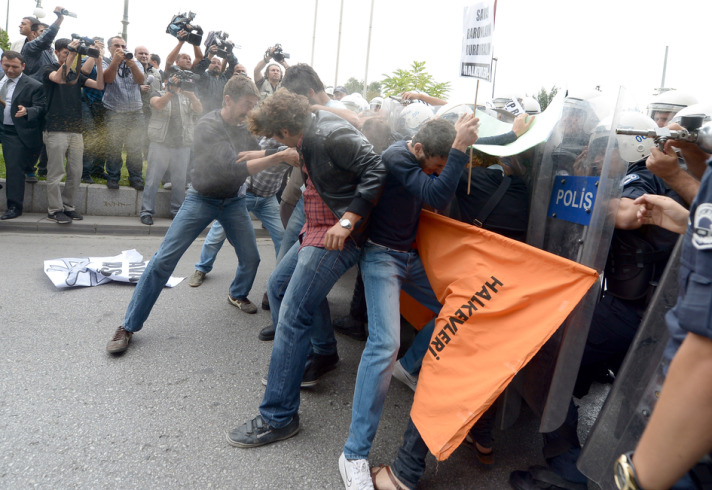 Turkish police teargas anti-war protesters near parliament
