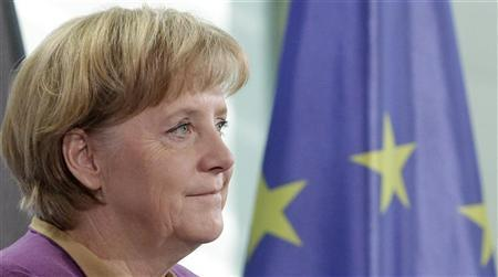 Merkel defends her minister against plagiarism charges