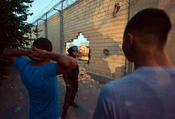 Palestinians smash holes in separation wall in E. Jerusalem