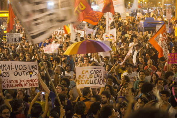 Police clash with crowd protesting cost of Pope visit