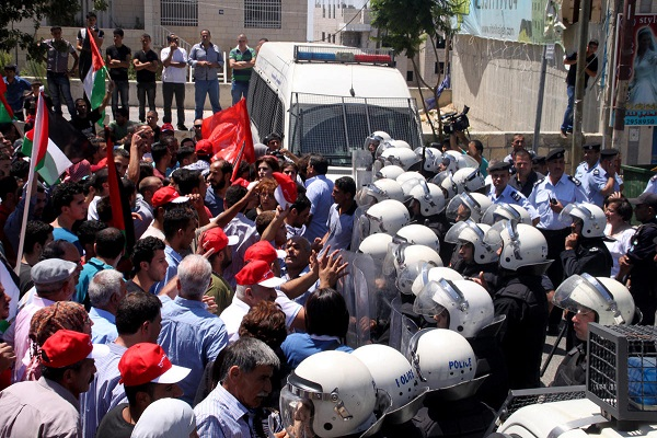 Palestinian police clash with refugees, 50 injured