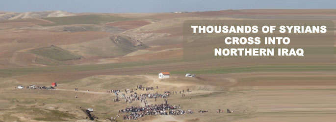 Thousands of Syrians cross into northern Iraq