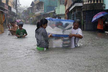 Seven dead, thousands displaced in floods in Philippines