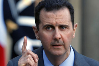 Assad says not ready to give up power