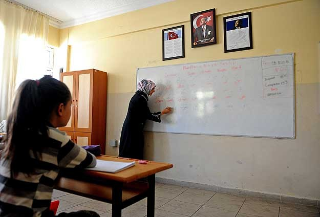 Female teachers fired in Turkey's 1997 coup go back to work