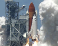 Discovery blasts off