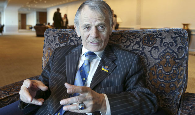 Crimean Tatar leader's wife hospitalized after home raided