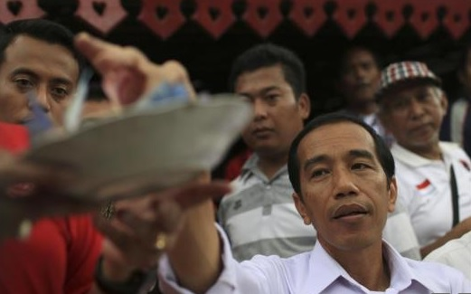 Both candidates in Indonesia election claim victory; Jokowi ahead
