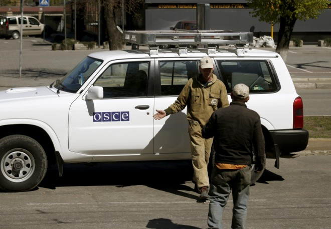 Four OSCE cars torched in eastern Ukraine