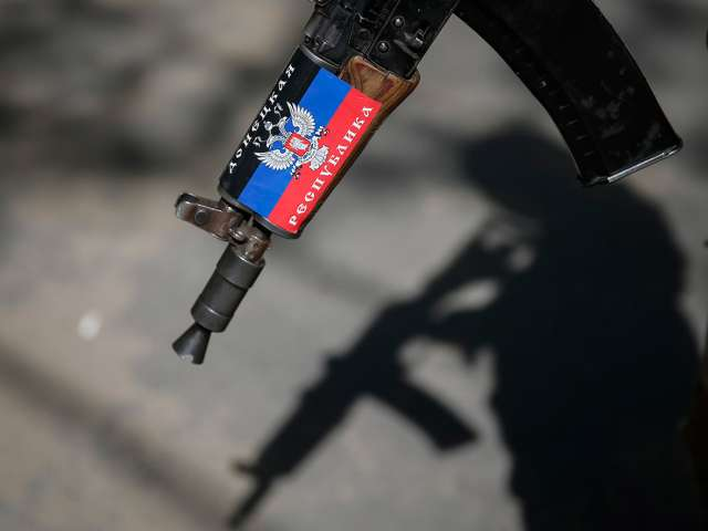 Ukraine says rebels keep up attacks into New Year