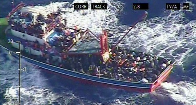 Greece tows migrant-packed ship to safety off Crete