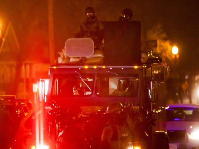 Protests in Ferguson, elsewhere muted