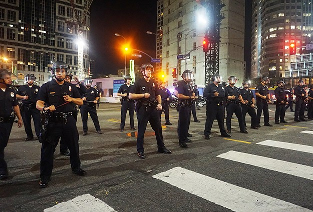 National Guard scales back, Ferguson protests probed