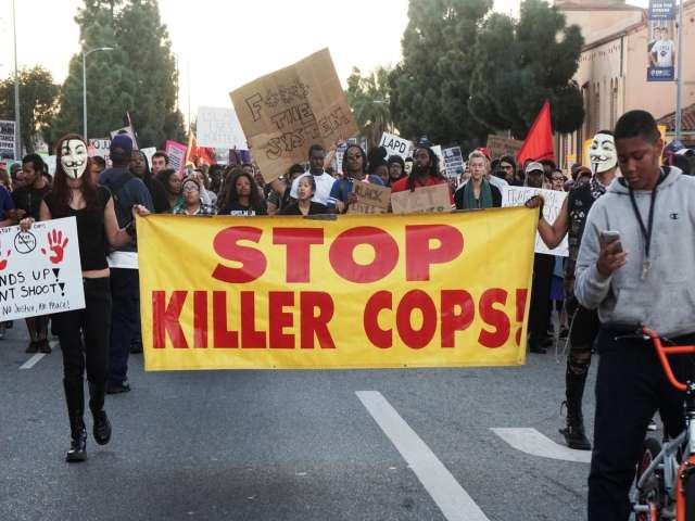 Ferguson police officer who killed black teen resigns from force
