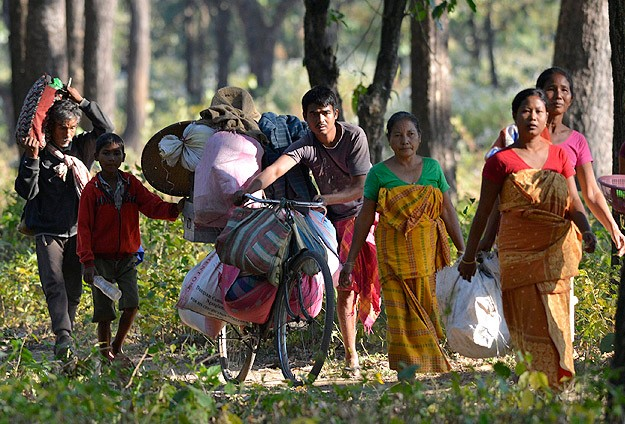 India: Assam violence displaces more than 100,000
