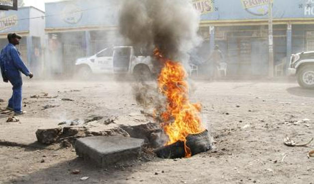 Police clash with Congo protesters for third day, govt says 15 dead
