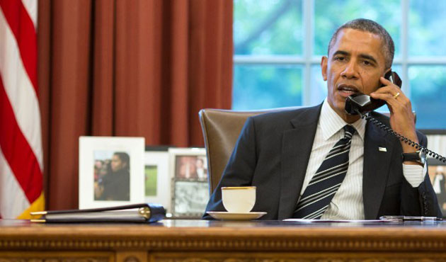 Obama urges Putin to remove troops from Ukraine